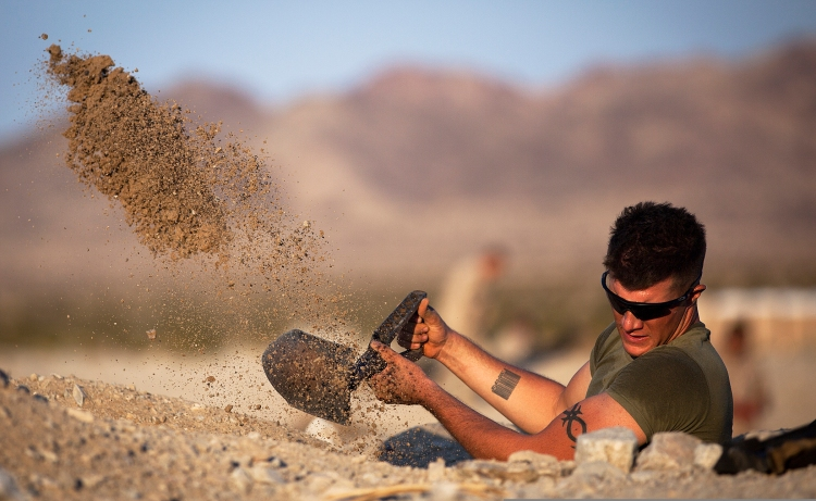 U.S. Marine Corps Cpl. Richard Mikesell digs a foxhole at Marine Corps Air Ground Combat Center Twentynine Palms, Calif., Sept. 16, 2011 (U.S. Marine Corps photo by Cpl. Reece Lodder/Released)
